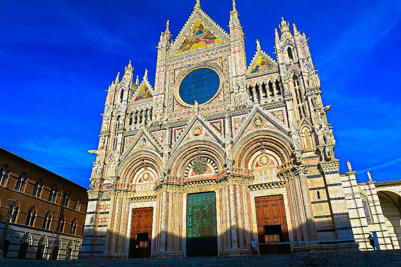 The facade of the Cathedral of Siena, Italy